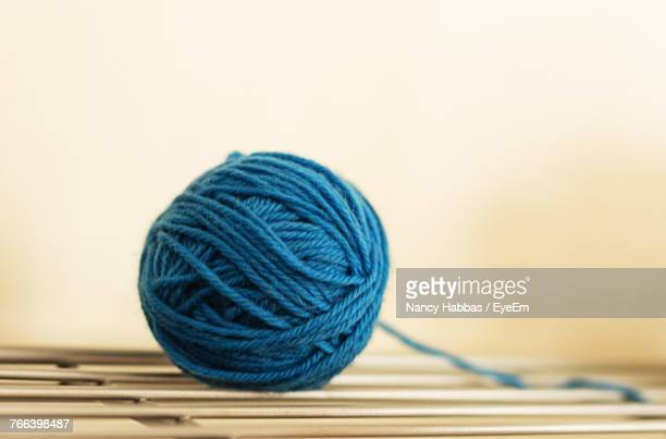 Close-Up Of Blue Woolen Ball On Table