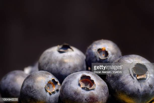 Close-Up Of Blueberries Against Black Background
