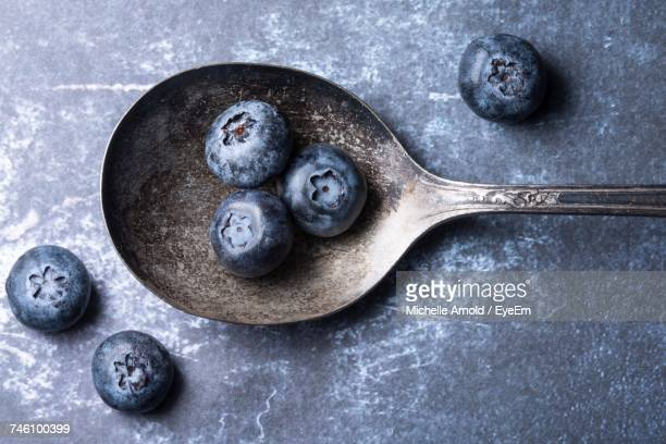Close-Up Of Blueberries In Old Fashioned Spoon On Table