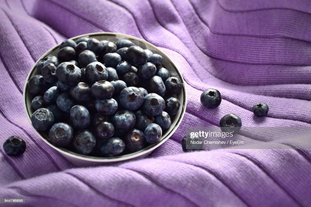 Close-Up Of Blueberries On Purple Fabric : Stock Photo