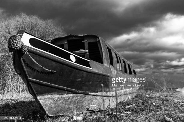 close-up of boat against sky - canal stock pictures, royalty-free photos & images