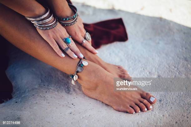 close-up of bohemian woman's hands and feet with fashionable jewelry - feet model stock pictures, royalty-free photos & images