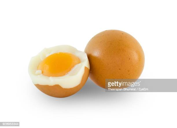 close-up of boiled eggs against white background - hard boiled eggs stock pictures, royalty-free photos & images