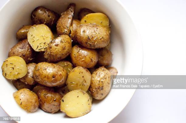 Close-Up Of Boiled Potatoes In Bowl On White Background