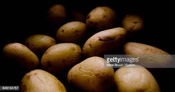 Close-Up Of Boiled Potatoes In Darkroom