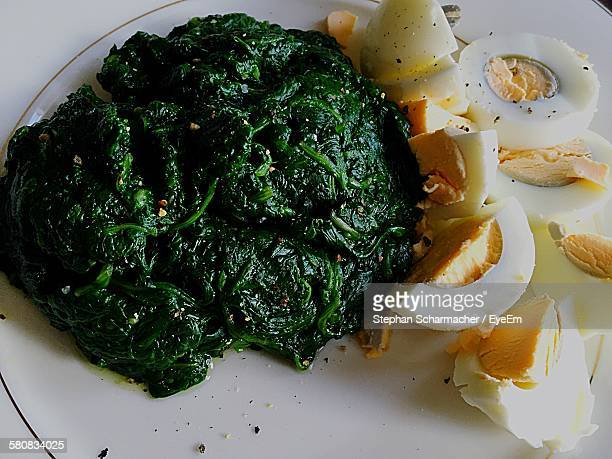 Close-Up Of Boiled Spinach And Eggs Served In Plate