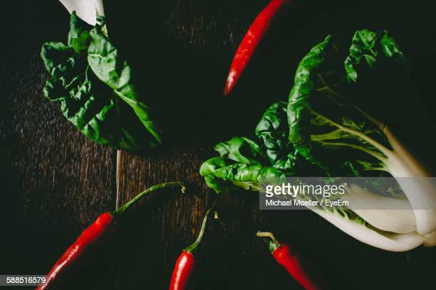Close-Up Of Bok Choy And Chili On Table