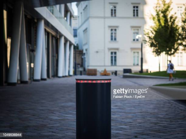 close-up of bollard at building - bollard stock photos and pictures