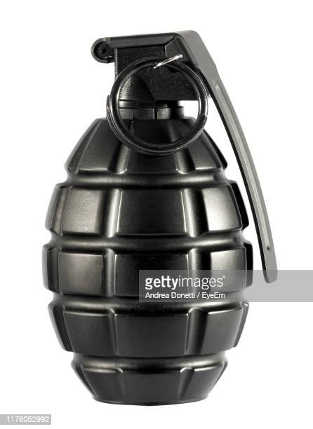 close-up of bomb against white background - weaponry stock pictures, royalty-free photos & images