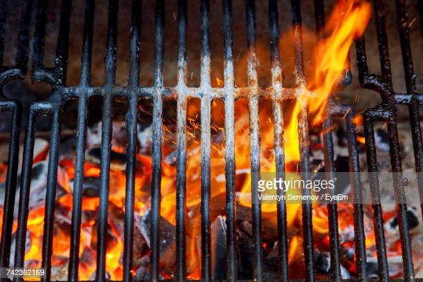 close-up of bonfire on barbecue grill - metal grate stock photos and pictures