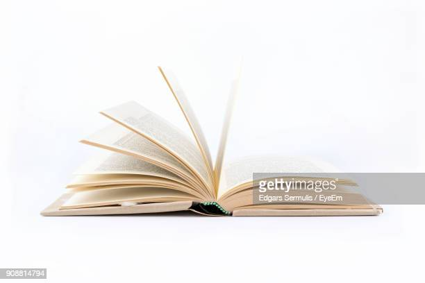 close-up of book against white background - book imagens e fotografias de stock