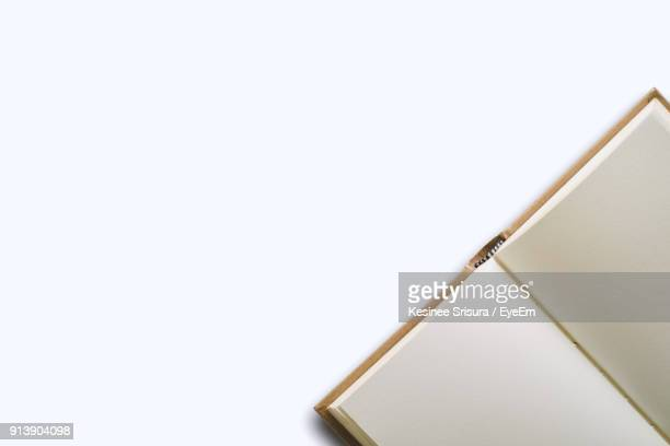 Close-Up Of Book Against White Background