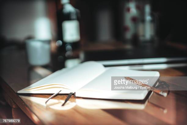 Close-Up Of Book And Pencil On Table