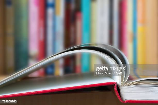 close-up of book on table - book store stock photos and pictures