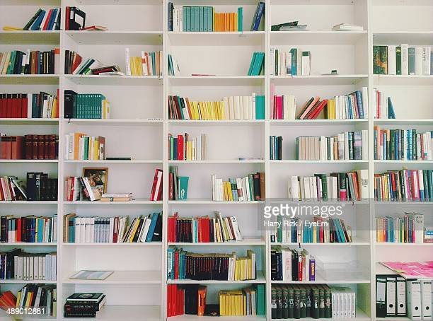 close-up of book shelf - neat stock pictures, royalty-free photos & images