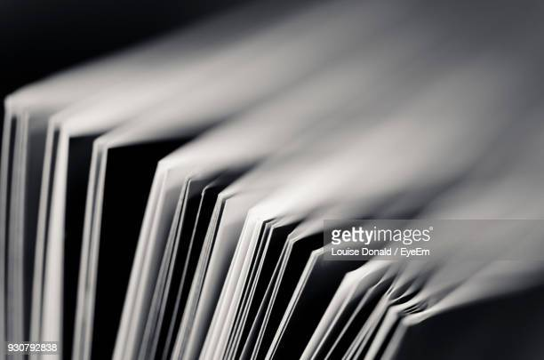 close-up of books against black background - equipamento à base de papel imagens e fotografias de stock