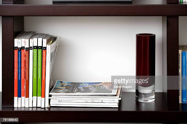close-up of books in shelves - glass magazine stock photos and pictures