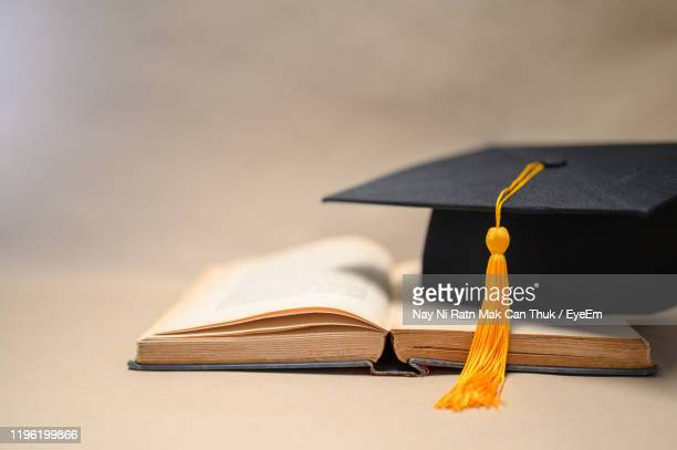 close-up of books on table - headwear stock pictures, royalty-free photos & images