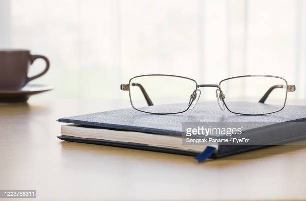 close-up of books on table - reading glasses stock pictures, royalty-free photos & images