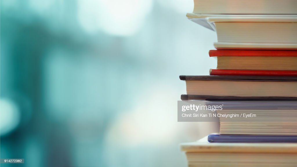Close-Up Of Books Stacked Over Table : Stock-Foto