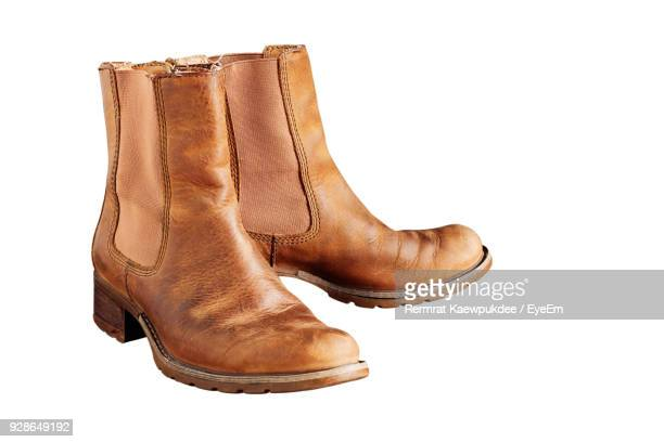 close-up of boot against white background - calzature di pelle foto e immagini stock