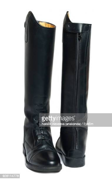 close-up of boot on white background - black boot stock pictures, royalty-free photos & images