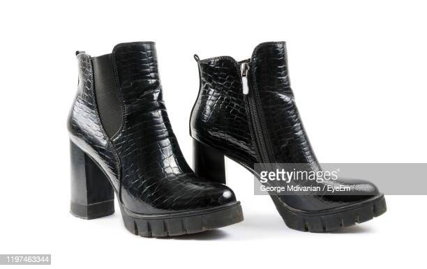 close-up of boots against white background - black boot stock pictures, royalty-free photos & images