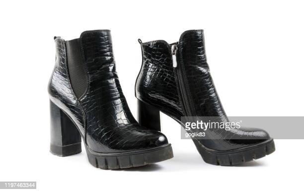 close-up of boots against white background - bottes noires photos et images de collection