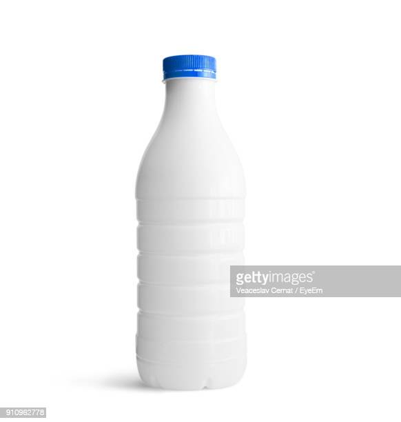 close-up of bottle against white background - milk bottle stock pictures, royalty-free photos & images
