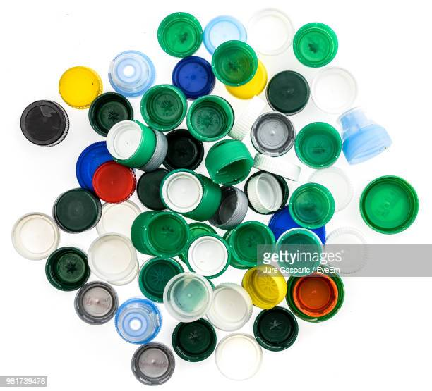 close-up of bottle caps over white background - lid stock photos and pictures