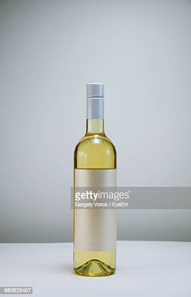 close-up of bottle on table - wine bottle stock pictures, royalty-free photos & images