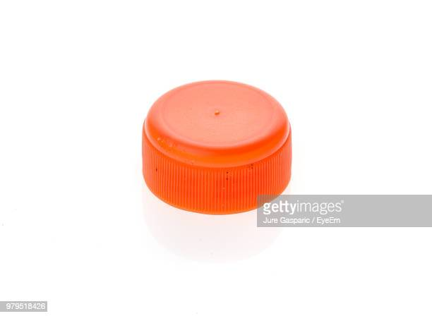 close-up of bottle over white background - lid stock photos and pictures