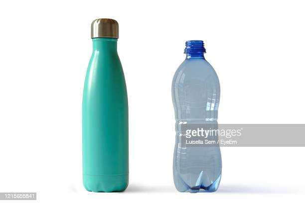 close-up of bottles against white background - water bottle stock pictures, royalty-free photos & images
