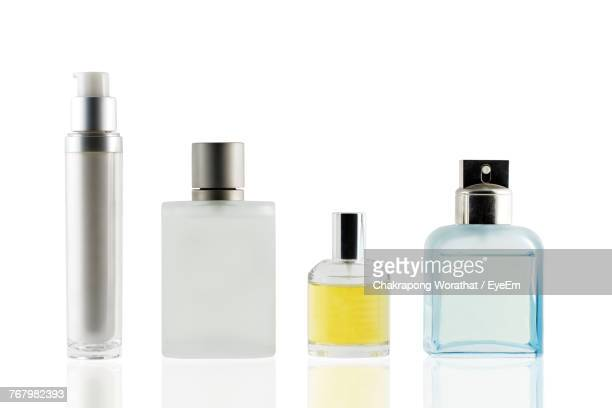 close-up of bottles against white background - cosmetics stock pictures, royalty-free photos & images