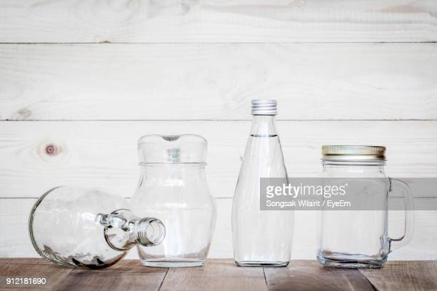 Close-Up Of Bottles And Containers On Table