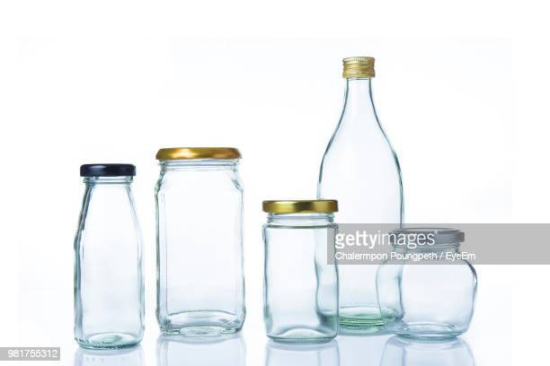 close-up of bottles and jars against white background - 広口瓶 ストックフォトと画像
