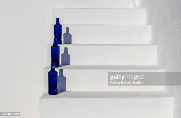 Close-Up Of Bottles On Steps