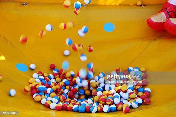 close-up of bouncing colorful play balls - bouncing ball stock photos and pictures