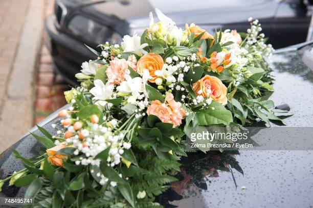 Close-Up Of Bouquet On Car At Wedding