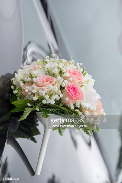 Close-Up Of Bouquet On Car During Wedding Ceremony