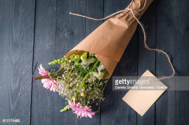 close-up of bouquet on wooden table - bunch stock pictures, royalty-free photos & images