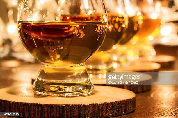 Close-Up Of Bourbon Whiskey In Glasses On Table