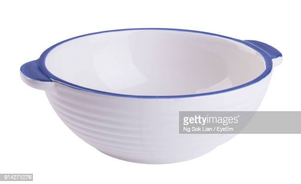 Close-Up Of Bowl Against White Background