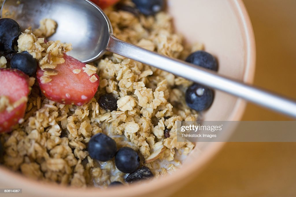 Close-up of bowl of cereal and berries : Stock Photo