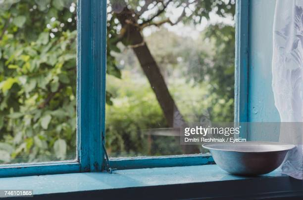 close-up of bowl on window sill - window sill stock pictures, royalty-free photos & images