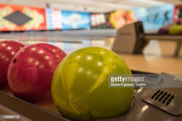 Close-Up Of Bowling Balls On Lane At Alley