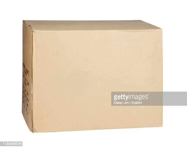 close-up of box against white background - carton stock pictures, royalty-free photos & images