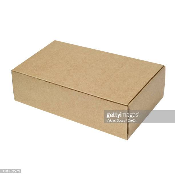 close-up of box against white background - cardboard box stock pictures, royalty-free photos & images