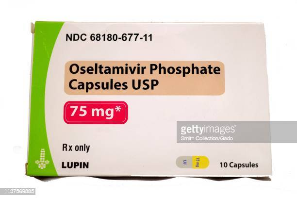 Closeup of box of Oseltamivir Phosphate tablets marketed under the brand name Tamiflu and used to treat the influenza virus isolated on white...