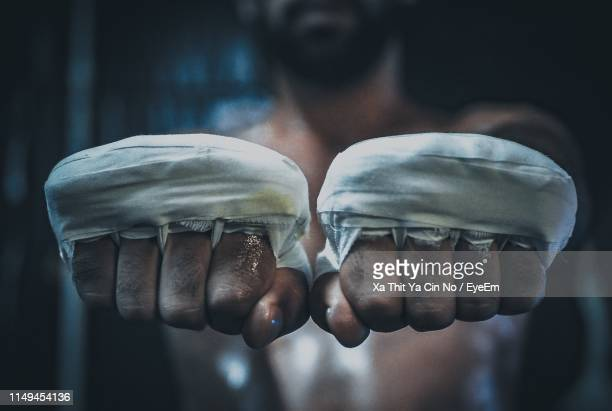 close-up of boxer hands with bandages - fighting stance stock pictures, royalty-free photos & images